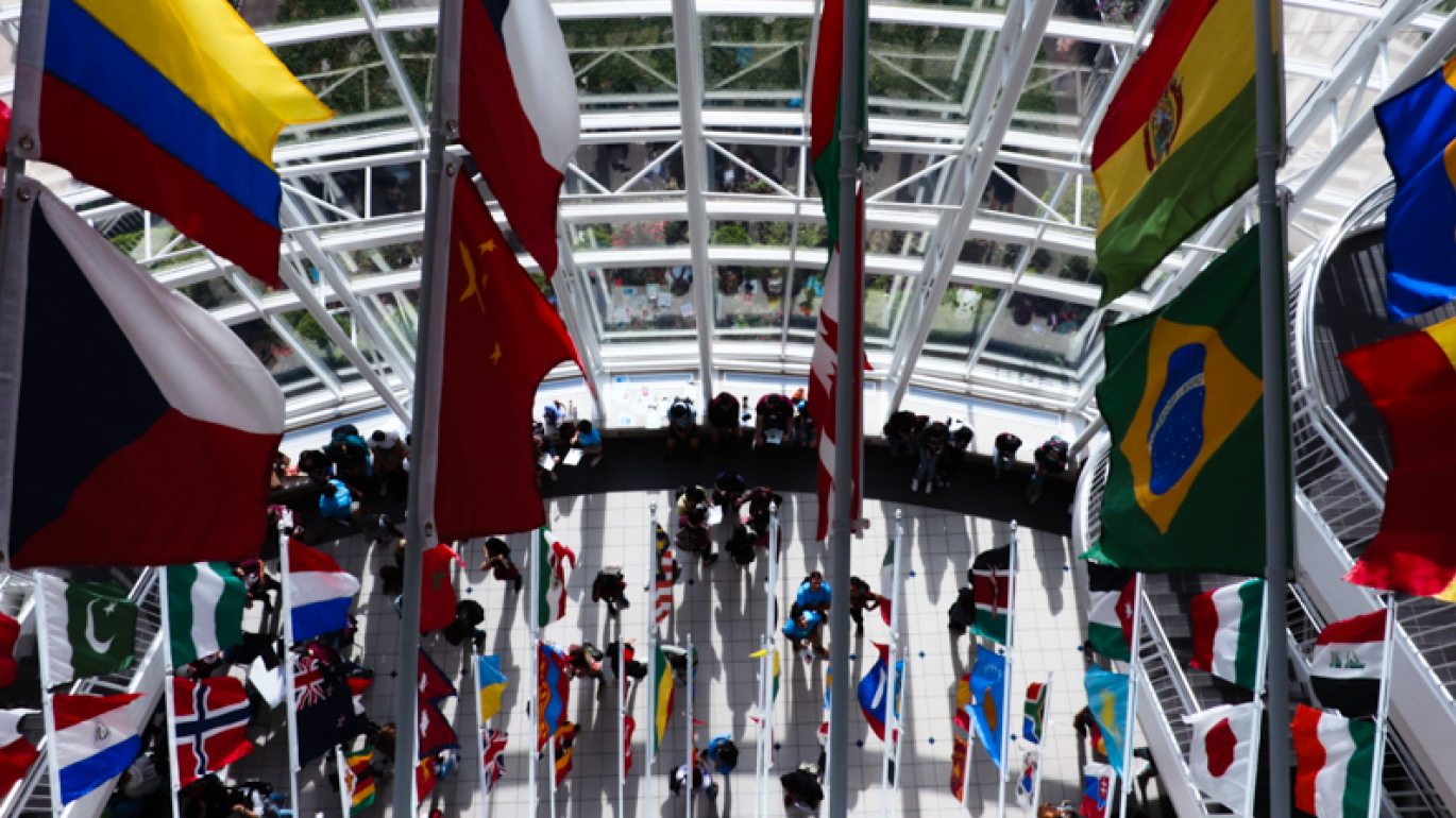 International flags hanging in Strong Hall on Missouri State University campus